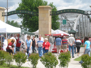 Residents enjoy the grand opening of the Grand Forks Greenway in 2003